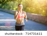 Young Smiling Sporty Woman...