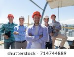 builders team leader over group ... | Shutterstock . vector #714744889