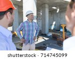 buiders on construction site ... | Shutterstock . vector #714745099