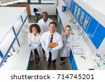 professor with mix race group... | Shutterstock . vector #714745201