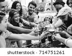 group of people cheering with... | Shutterstock . vector #714751261