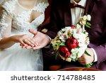 wedding rings in the hands of... | Shutterstock . vector #714788485