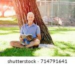 Senior Man Sittingin Park Whil...