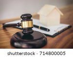 gavel on sounding block at... | Shutterstock . vector #714800005