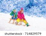 little girl and boy enjoy a... | Shutterstock . vector #714829579
