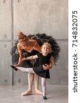 a young woman ballerina in a... | Shutterstock . vector #714832075