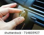 hand on volume control of car... | Shutterstock . vector #714835927