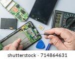 broken cell phone repair.... | Shutterstock . vector #714864631
