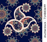 seamless paisley pattern with... | Shutterstock . vector #714883699