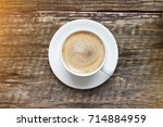 a cup of coffee with cappuccino ... | Shutterstock . vector #714884959