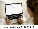 businesswoman typing e mail on... | Shutterstock . vector #714889417