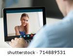man talking to shy beautiful... | Shutterstock . vector #714889531