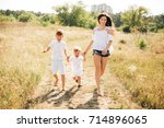 mother with two sons runnig... | Shutterstock . vector #714896065