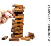 isolated hand on wood tumbling... | Shutterstock . vector #714920995