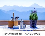 table and chairs at a sidewalk... | Shutterstock . vector #714924931