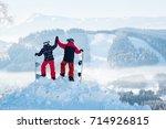 shot of a couple high fiving... | Shutterstock . vector #714926815