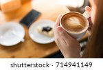 woman hands take a coffee in... | Shutterstock . vector #714941149