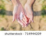 woman holds a white feather of... | Shutterstock . vector #714944209