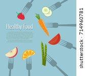 vegetables and fruits on forks. ...   Shutterstock .eps vector #714960781
