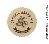 organic argan oil emblem with... | Shutterstock .eps vector #714960967