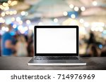 laptop empty screen on... | Shutterstock . vector #714976969