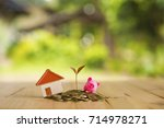house placed on coins men's... | Shutterstock . vector #714978271