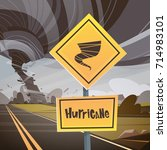 road sign warning about tornado ... | Shutterstock .eps vector #714983101