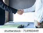 businessman shaking hands... | Shutterstock . vector #714983449