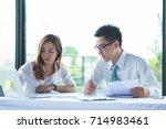 business women and businessman... | Shutterstock . vector #714983461