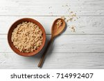 cooked quinoa in bowl on white... | Shutterstock . vector #714992407