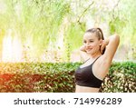 fit and sporty girl doing... | Shutterstock . vector #714996289