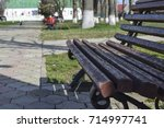 a brown bench in the park. the...   Shutterstock . vector #714997741