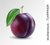 ripe plum with green leaves on... | Shutterstock .eps vector #714999409
