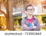 handsome  intelligent boy with ... | Shutterstock . vector #715001869