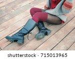 female legs dressed in knee... | Shutterstock . vector #715013965