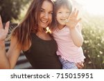 picture of mother and child... | Shutterstock . vector #715015951