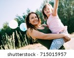 picture of mother and child... | Shutterstock . vector #715015957