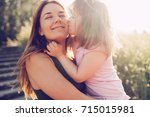 picture of mother and child... | Shutterstock . vector #715015981