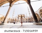 a young muslim woman in a scarf ...   Shutterstock . vector #715016959