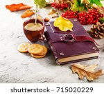 autumn still life with cup... | Shutterstock . vector #715020229