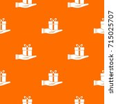 gift box in hand pattern repeat ... | Shutterstock .eps vector #715025707