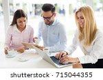 workteam in office working... | Shutterstock . vector #715044355