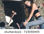 selective focus of young woman... | Shutterstock . vector #715050445