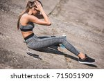 side view of athletic woman... | Shutterstock . vector #715051909
