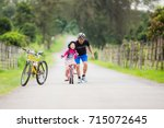 dad teaches his daughter to... | Shutterstock . vector #715072645