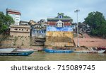 Small photo of Varanasi, India - Jul 12, 2015. Landscape of the Ganges River with boats in Varanasi, India. Varanasi is one of the most fascinating places on earth, surprises abound around every corner.