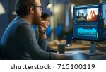 male video editor works with... | Shutterstock . vector #715100119