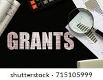 text grants  on chalkboard with ... | Shutterstock . vector #715105999