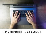 top view hands typing on laptop ... | Shutterstock . vector #715115974