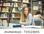 pretty female student with... | Shutterstock . vector #715123651